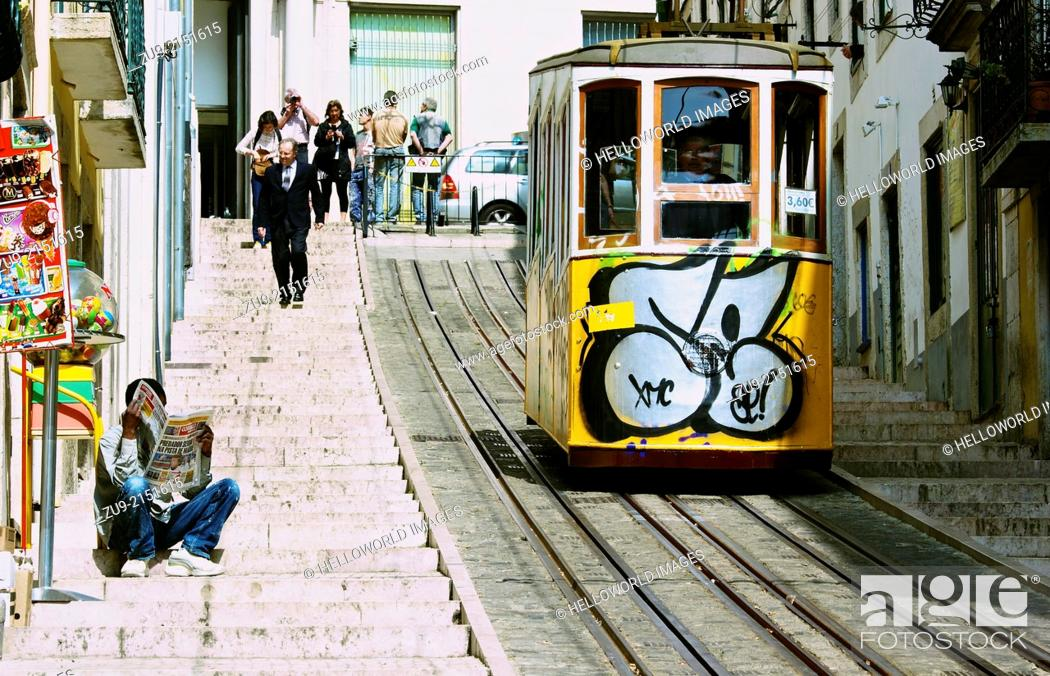 Stock Photo: Opened in 1892 the Elevador Da Bica funicular passes through the lively district of Bica, Lisbon, Portugal, Europe.