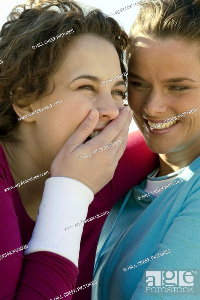 Stock Photo: Two women laughing and joking.