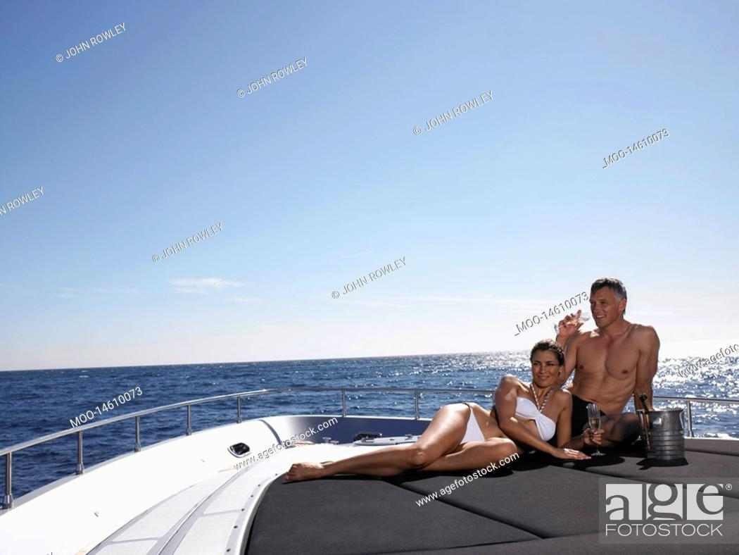 Stock Photo: Couple Drinking Champaign on Boat.