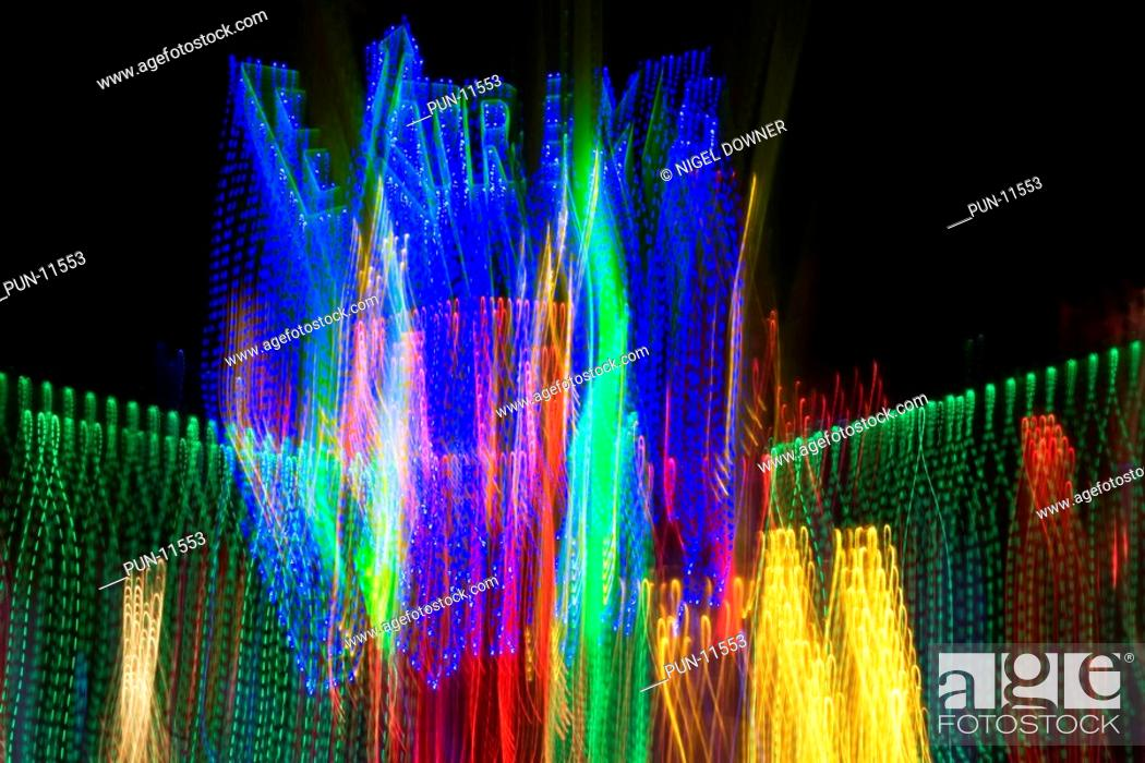 An energetic abstract of the lights of a fairground 'Extreme