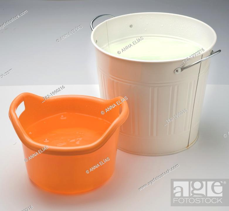 Stock Photo: two buckets with water on white background.