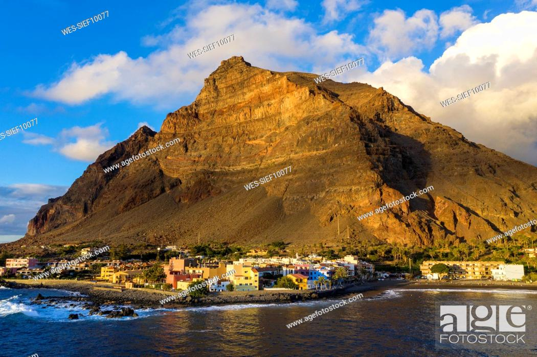 Stock Photo: Town and mountain on island surrounded with sea.