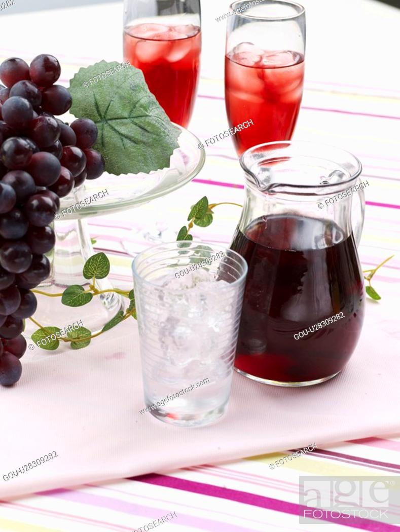 Stock Photo: icecube, grape juice, ice, glassware, glass cup, tablecloth, grape.