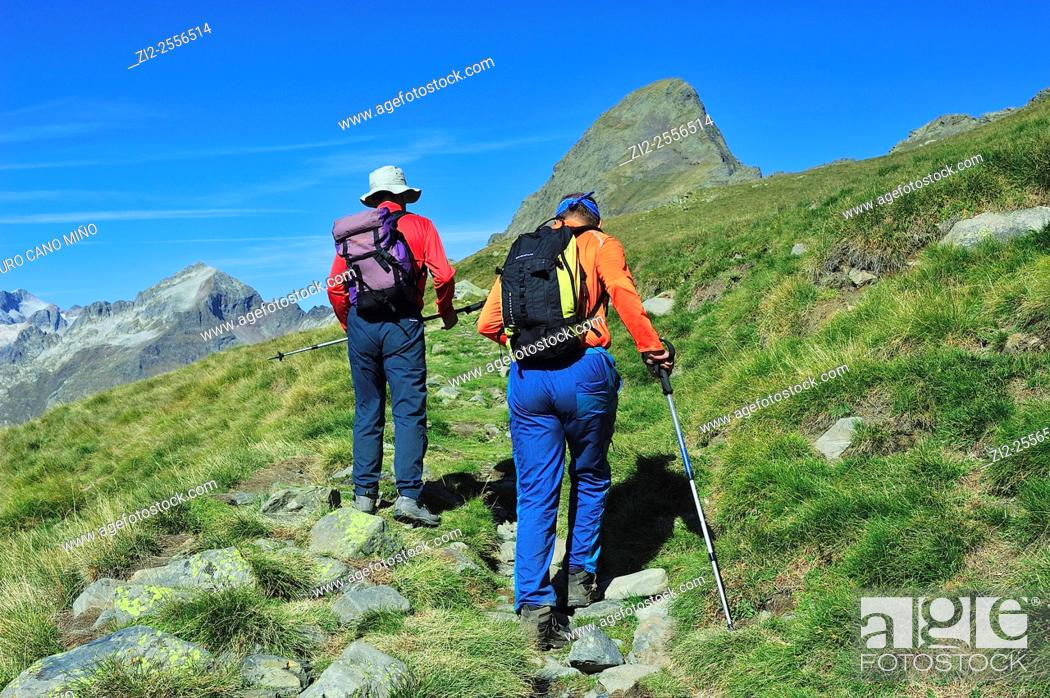Stock Photo: Two mountaineers walking towards the Peak Salvaguardia 2736 mts. Aragonese Pyrenees. Benasque, Huesca, Spain.