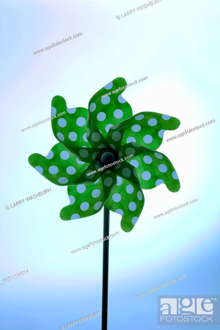Stock Photo: A green pinwheel with polka dots.