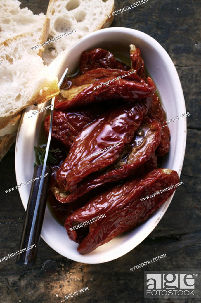 Stock Photo: Marinated dried tomatoes, white bread.