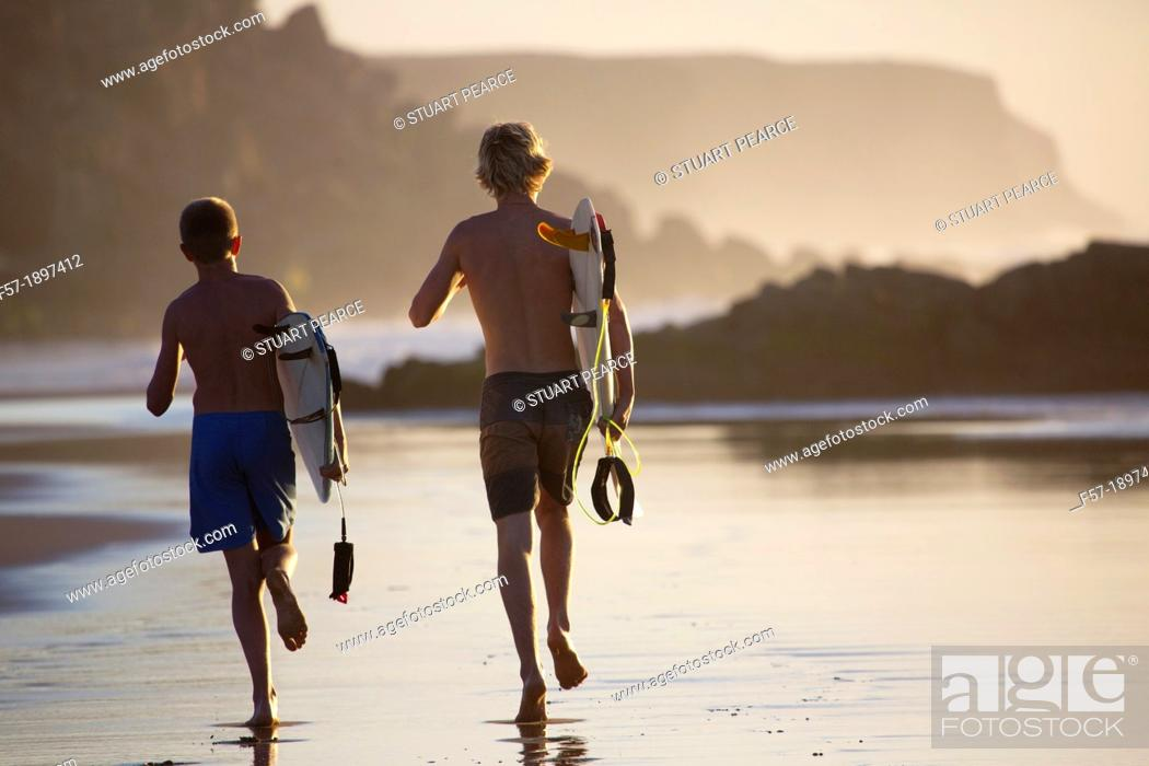Stock Photo: Two young surfers on Cotillo beach in Fuerteventura, Spain.