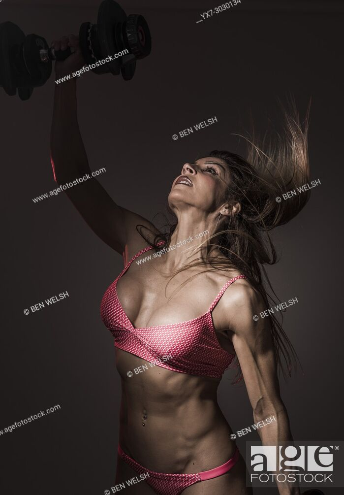 Stock Photo: Fit woman working out at the gym.