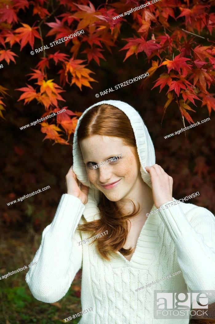 Stock Photo: Autumn portrait of young woman.