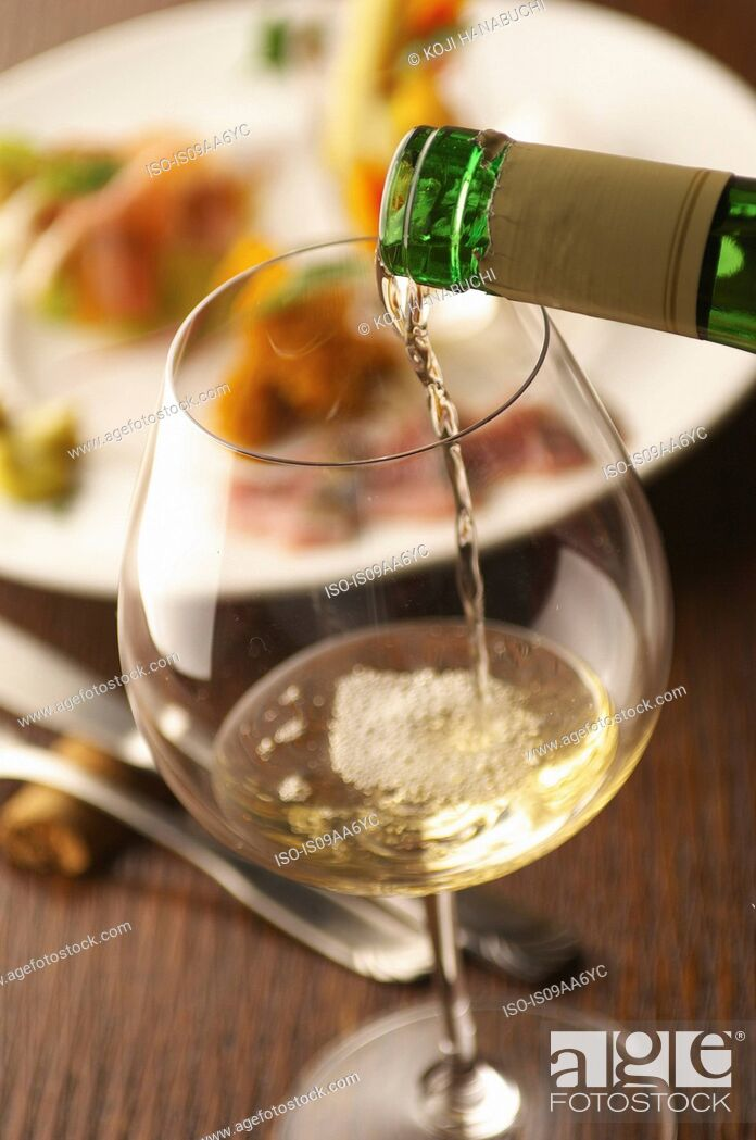 Stock Photo: Still life of white wine pouring into glass.