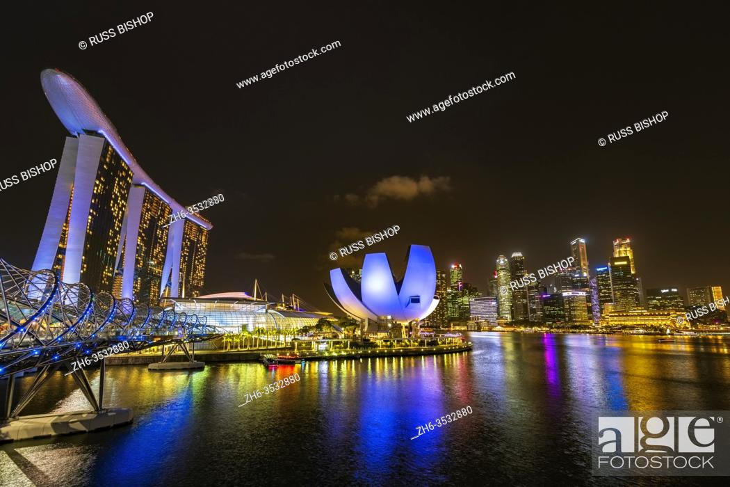 Imagen: The ArtScience Museum, Marina Bay Sands, and downtown skyline from the Helix Bridge at night, Singapore, Republic of Singapore.