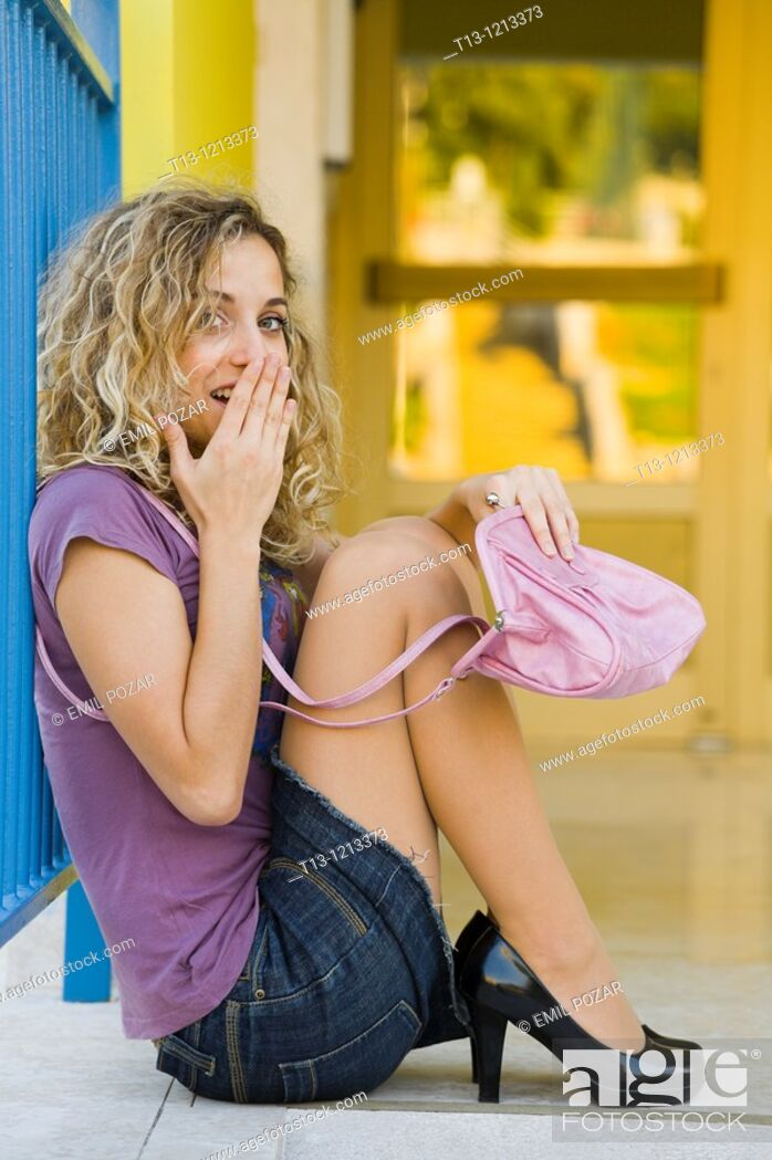 Stock Photo: Sitting young woman is surprised.