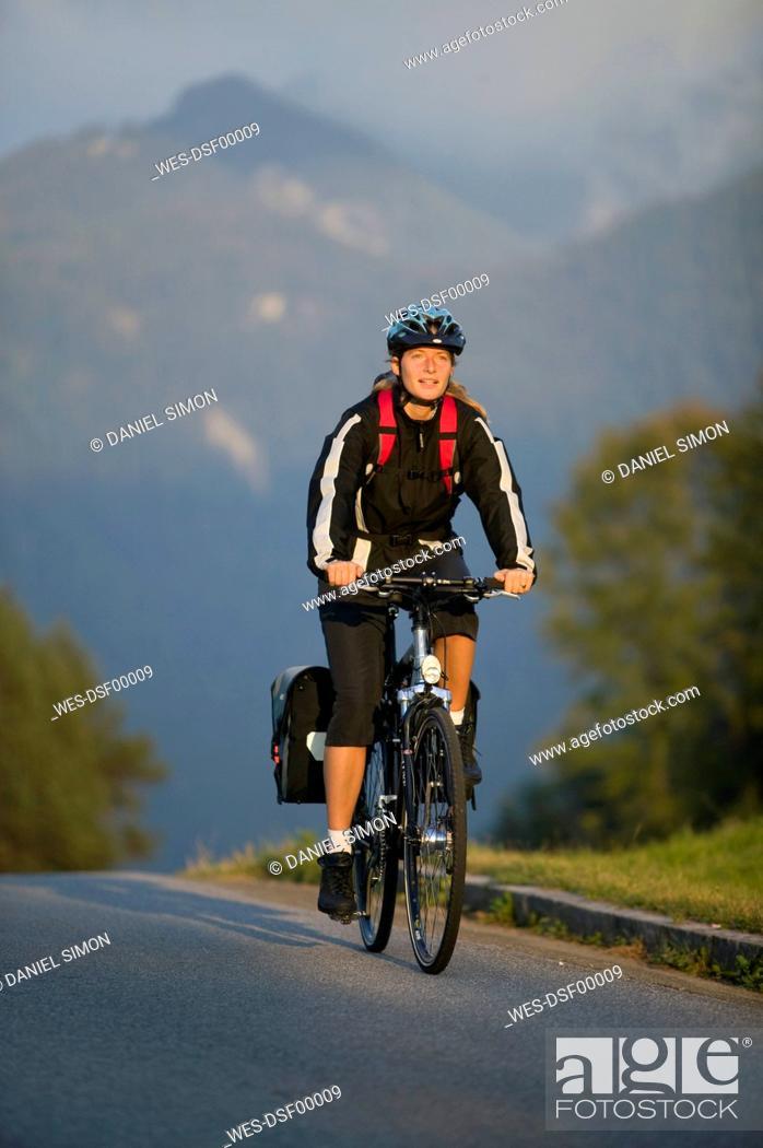 Stock Photo: Germany, Bavaria, Mittenwald, Woman mountain biking.
