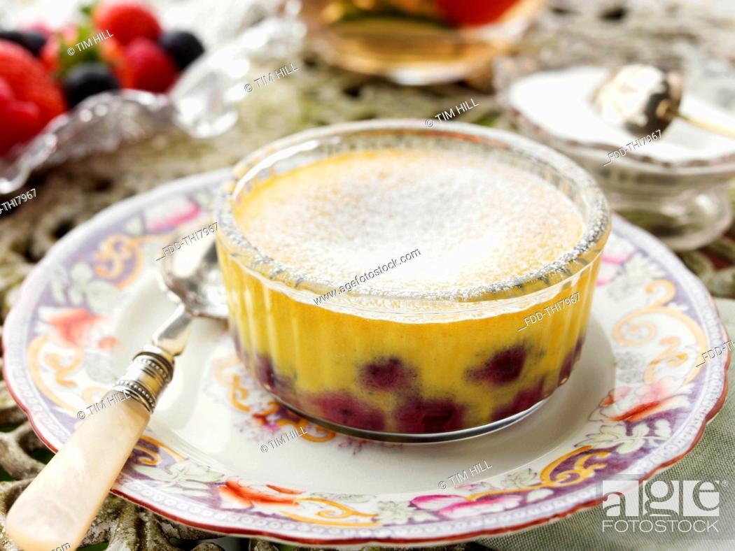 Stock Photo: Individual blueberry clafoutis on a garden table.