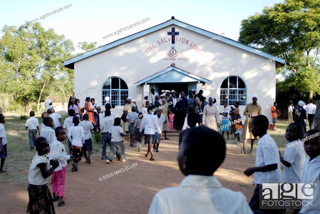 Stock Photo: Zimbabwe, Mashonaland Central, Nyachuru Township. May 2010. End of the Sunday Service at the Salvation Army Nyachuru Citadel.