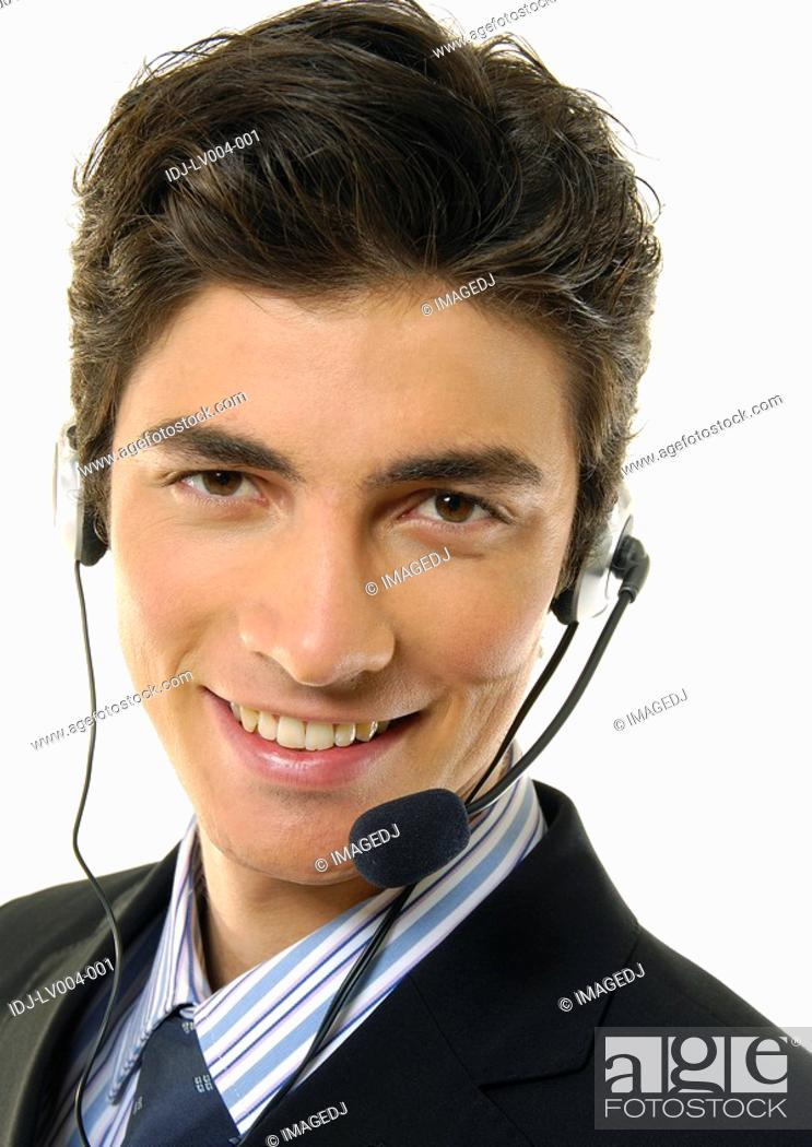 Stock Photo: Portrait of a businessman wearing a headset and smiling.