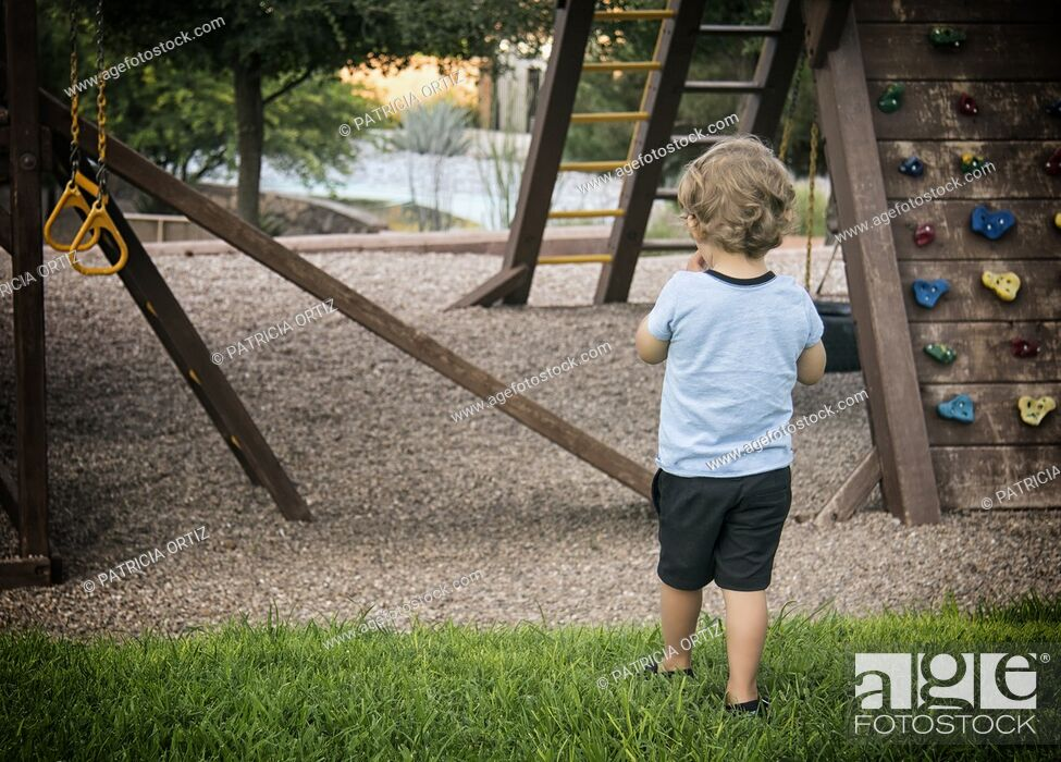 Stock Photo: Toddler in playground in Chihuahua, Mexico.