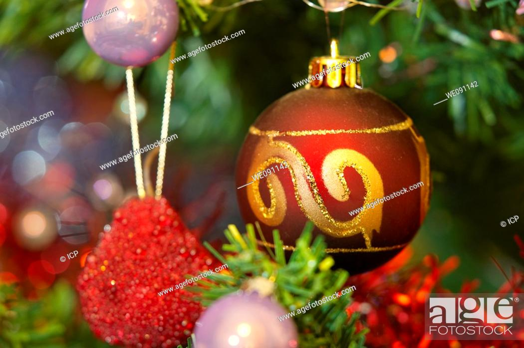 Stock Photo: Christmas tree bauble decorations with tinsel.