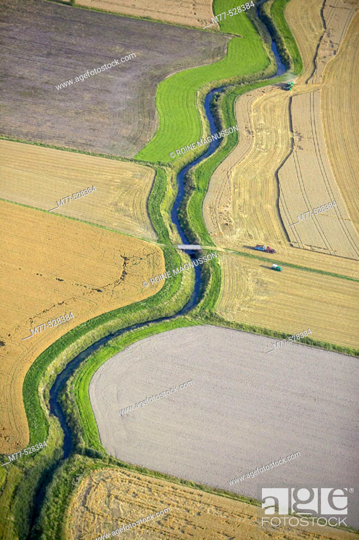 Stock Photo: Small stream in agricultural landscape, autumn, aerial view. Närke, Sweden.