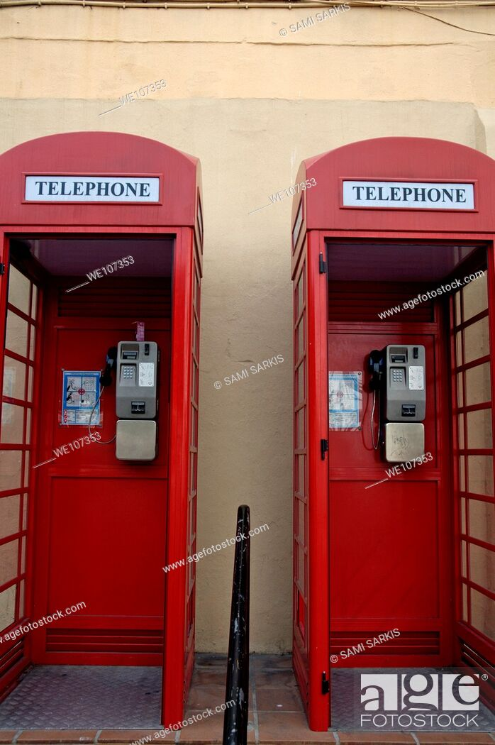Stock Photo: Two old-fashioned public telephone boxes in Gibraltar, British Overseas Territory, England.