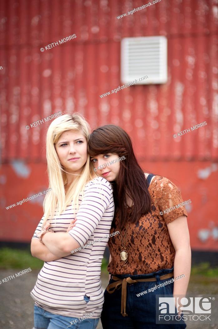 Stock Photo: Two 16 17 year old teenage girls, UK.