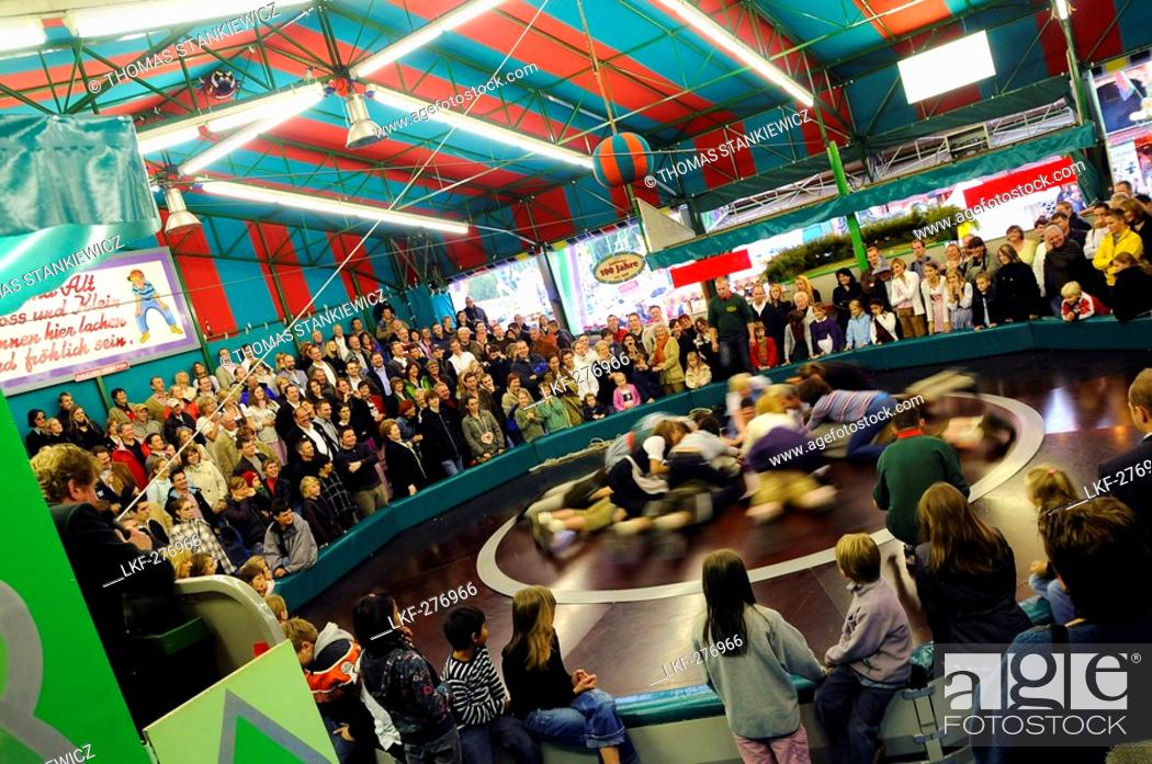 Stock Photo: People at the attraction Teufelsrad, Oktoberfest, Munich, Bavaria, Germany, Europe.