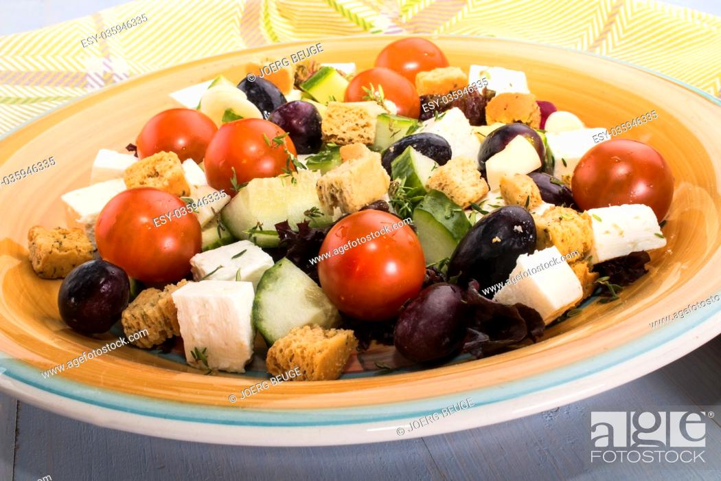 Stock Photo: mediterranean salat with black olive, grape, goat cheese and croutons on a plate.