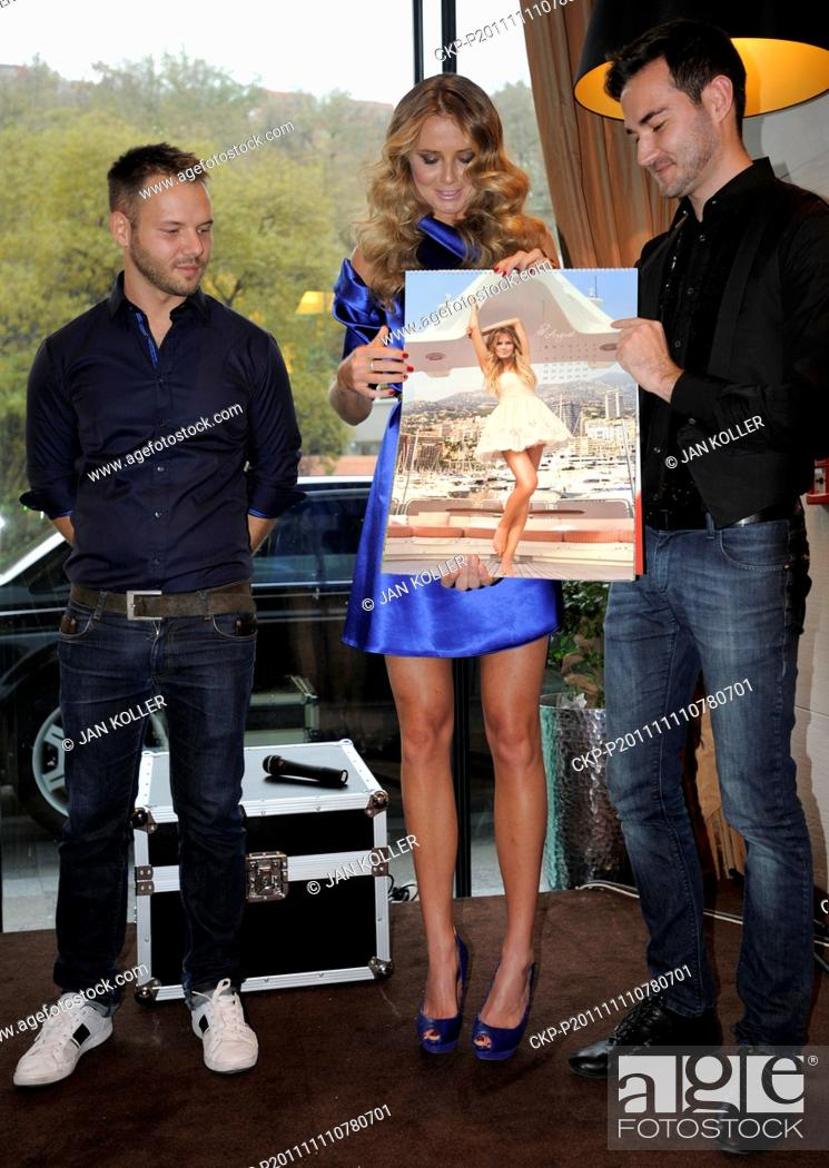 Stock Photo: ***FILE PHOTO*** Slovak tennis player Daniela Hantuchova, center, presents her new calendar in Bratislava, Slovakia, on November 11, 2011.
