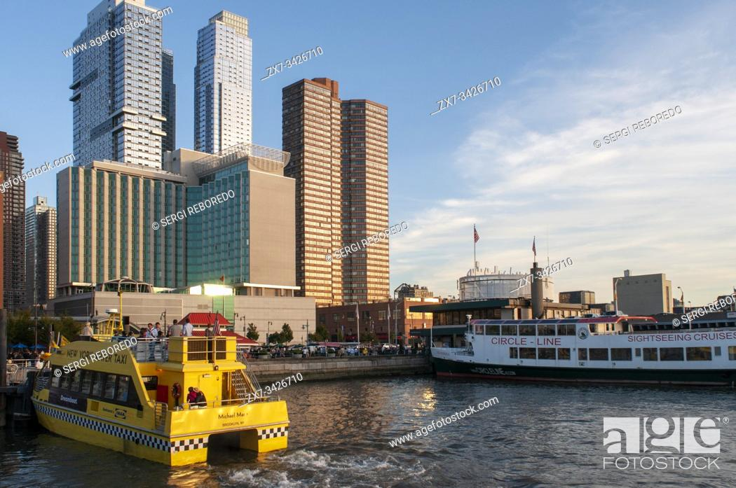 Photo de stock: New York water taxi and Circle line sightseeing cruises in Hudson River, New York, USA. Sightseeing Cruise Circle Line. Boat Tour Journey Down the Hudson River.