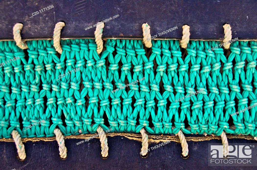 Stock Photo: trawl nets details left on fishing harbour quay Saint Vaast la Hougue Manche 50 france.