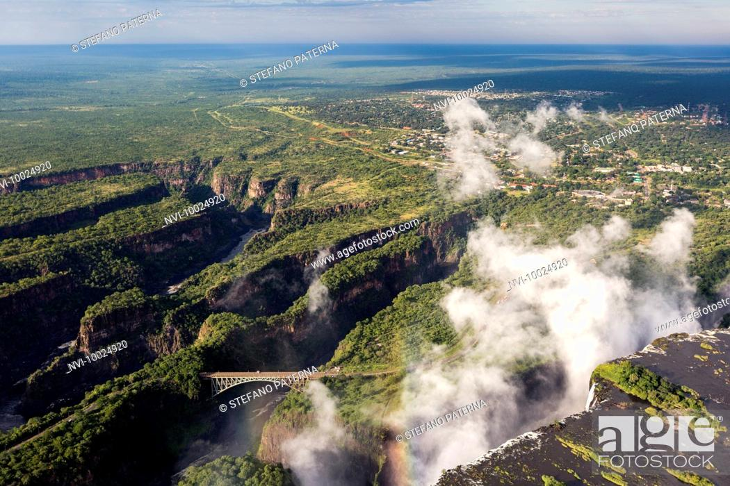 Stock Photo: Victoria Falls of the Zambezi River between border towns of Victoria Falls in Zimbabwe and Livingstone in Zambia, Africa.