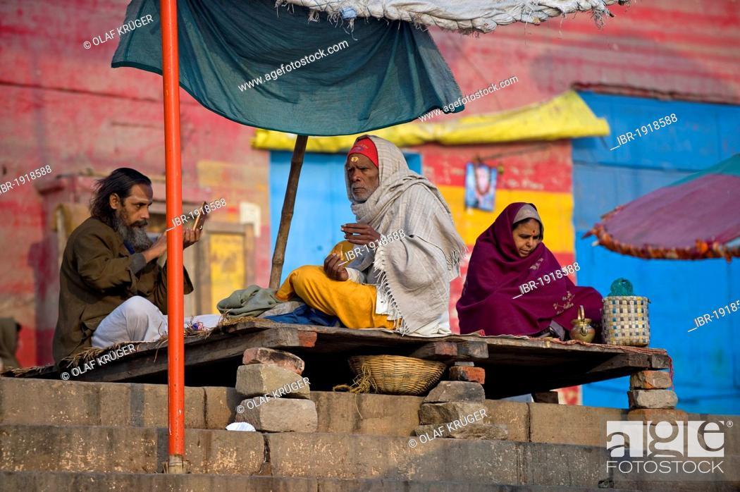 Stock Photo: Men at the Ghats or holy stairs, Ganges, Varanasi, Uttar Pradesh, India, Asia.