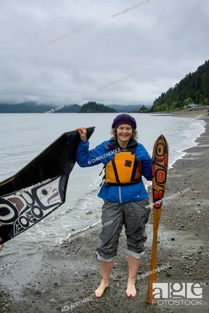 Stock Photo: Visitor with Loo Plex, replica of the Bill Reid cedar canoe, Lootaas, Wave Eater, Skidegate, Haida Gwaii, formerly known as Queen Charlotte Islands.