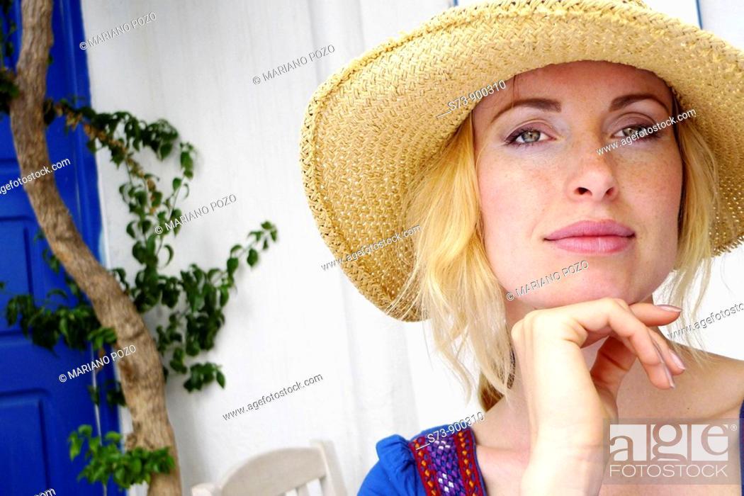 Stock Photo: 30 year old woman in a Mykonos, Cyclades Islands, Greece, Europe.