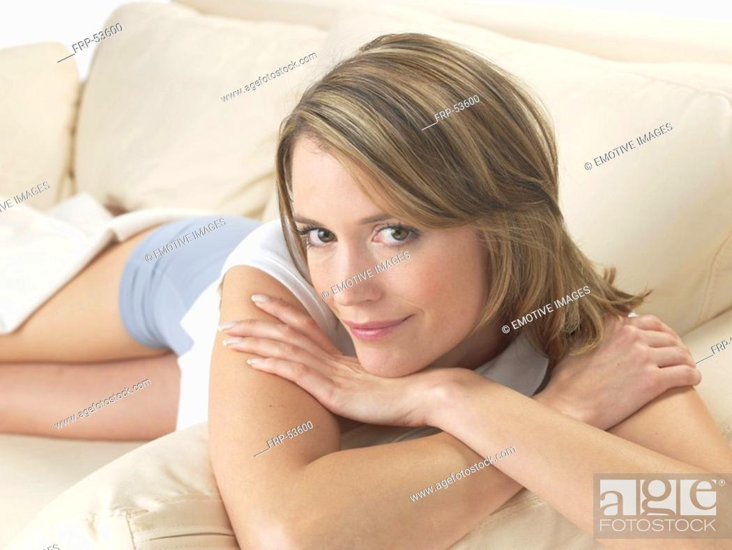 Stock Photo: Woman on the sofa.