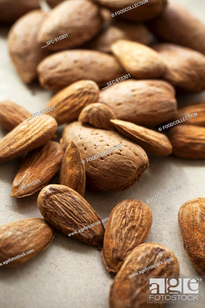 Stock Photo: Shelled and unshelled almonds.