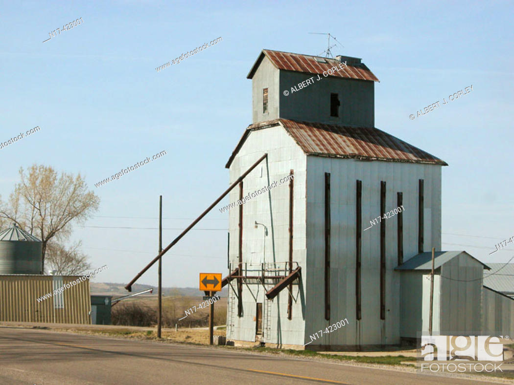 Stock Photo: Old grain elevator at railroad, midwestern United States.