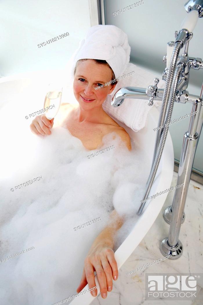 Stock Photo: Mature woman enjoying bubble bath.