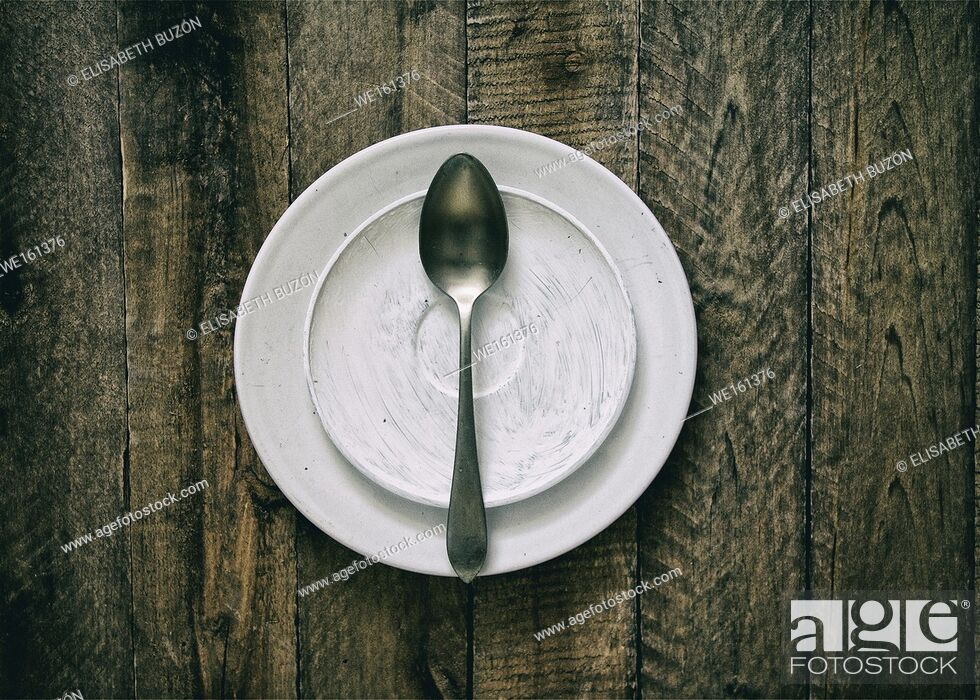 Stock Photo: Dish and spoon on wood.