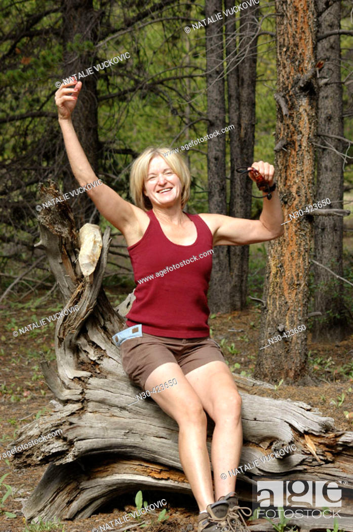 Stock Photo: Senior woman taking a break from hiking in mountains.