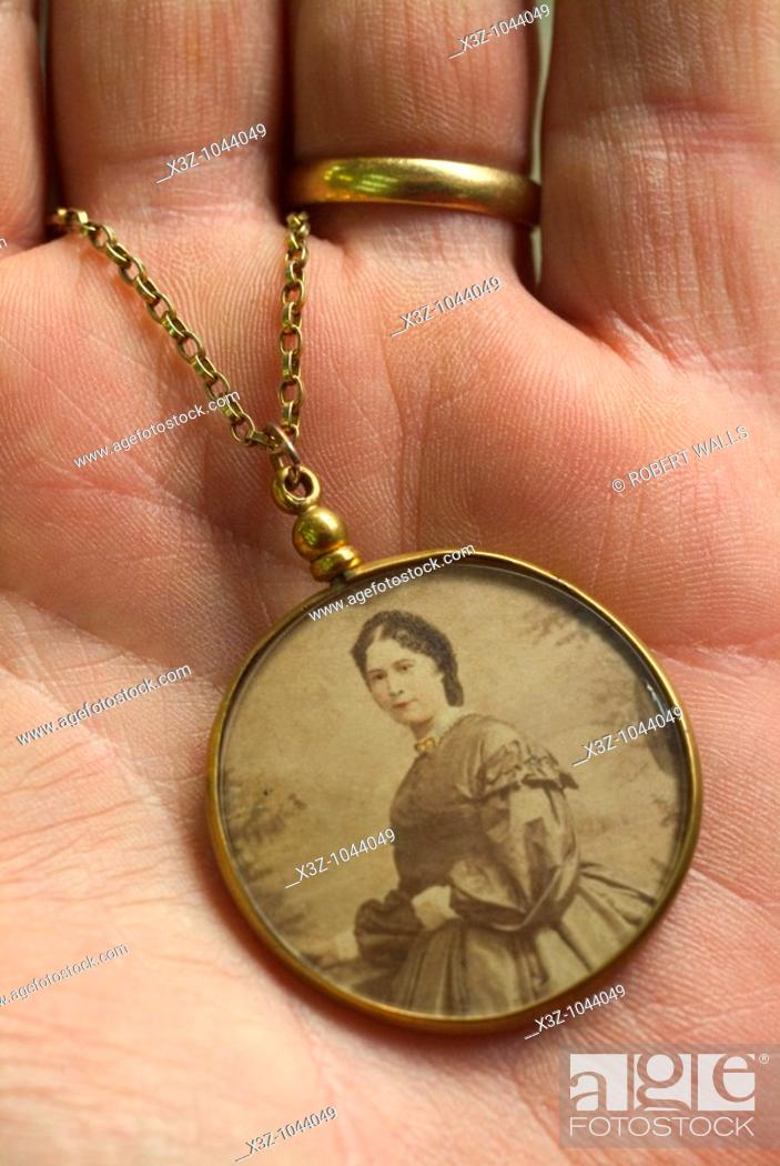 Stock Photo: An antique photo frame on a gold chain circa 1860.
