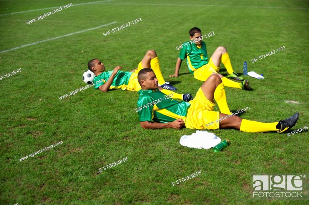 Stock Photo: Brazilian kickers lying on grass.