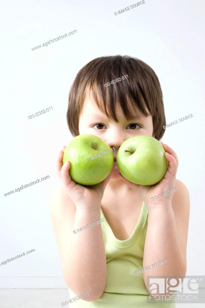 Stock Photo: Boy with two apples.