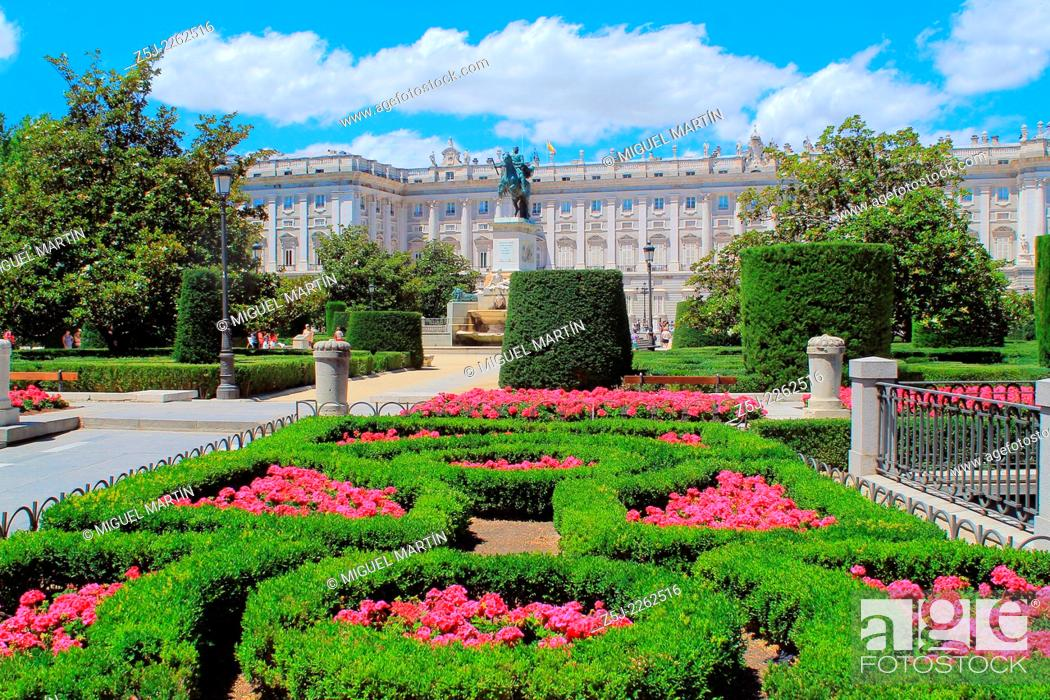 Stock Photo: The great and imposing Palacio Real (Royal Palace) of Madrid, seen here in June from Plaza de Oriente gardens centered by a statue to Philipp IV.