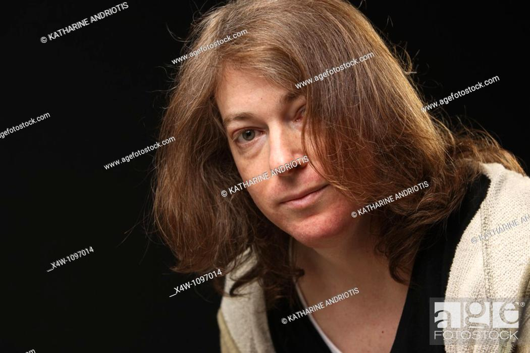 Stock Photo: Portrait of male to female transgender woman in mid-transition.