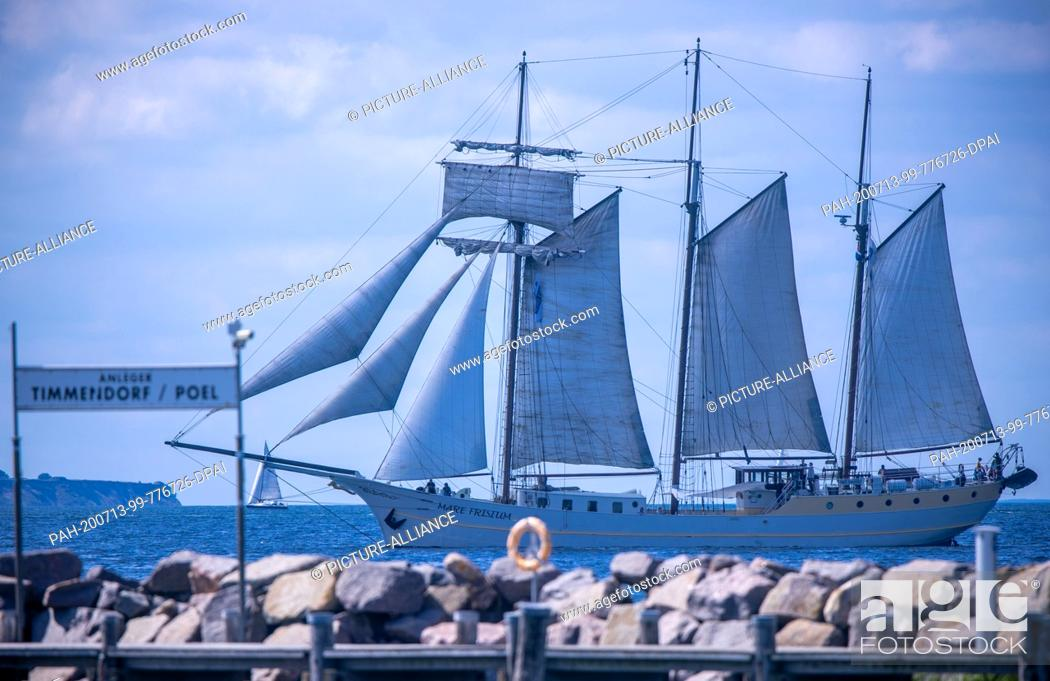 """Stock Photo: 13 July 2020, Mecklenburg-Western Pomerania, Timmendorf (poel): The sailing ship """"""""Mare Frisium"""""""" from the Netherlands sails through the Bay of Wismar and heads."""