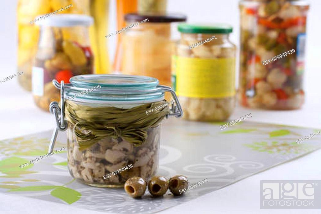 Pickle Jar Winter Ideas Taste Of Summer On Your Table Olives And Garlic In A Olive Oil Stock Photo Picture And Low Budget Royalty Free Image Pic Esy 039949439 Agefotostock