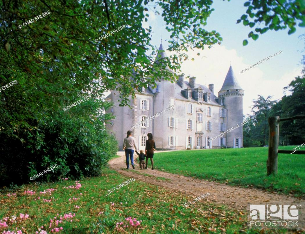 Stock Photo: Strolling along park pathways at Chateau Château Nexon in France.