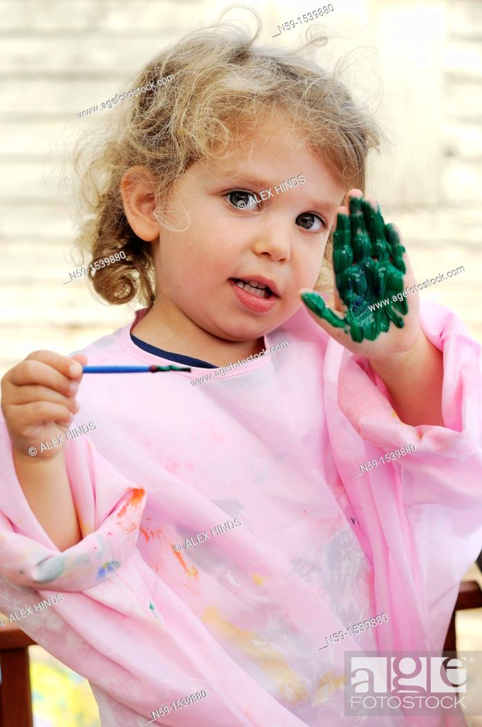 Stock Photo: Little girl painting.
