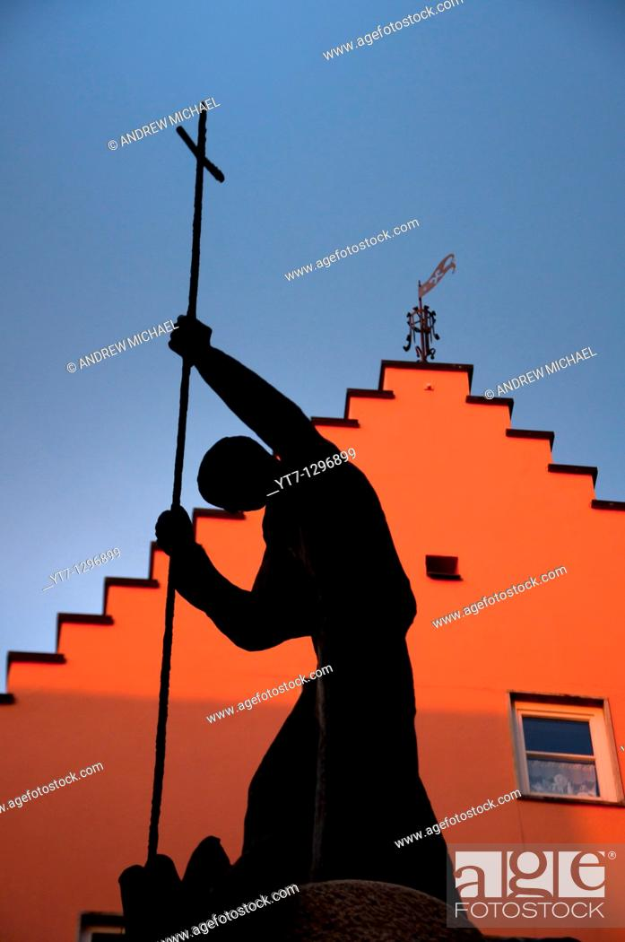Stock Photo: Silhouette of a religious statue at Fussen in the Romantic road, Bavaria, Germany.